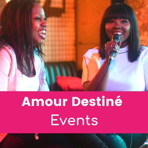 Amour Destiné Events - two black women sitting smiling on stage